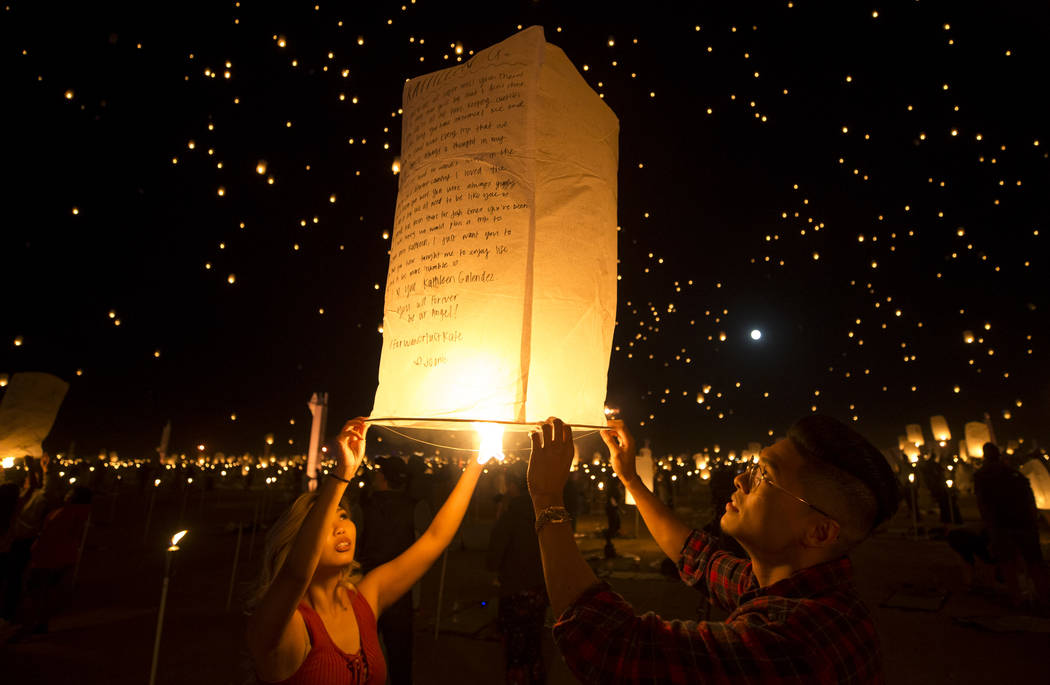 Participants ignite a lantern during the RiSE Lantern Festival held at the Moapa River Indian Reservation on Friday, Oct. 6, 2017. Richard Brian Las Vegas Review-Journal @vegasphotograph