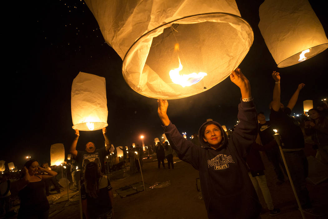 Abigail Arres, 11, of California releases a lantern during the RiSE Lantern Festival held at the Moapa River Indian Reservation on Friday, Oct. 6, 2017. Richard Brian Las Vegas Review-Journal @veg ...