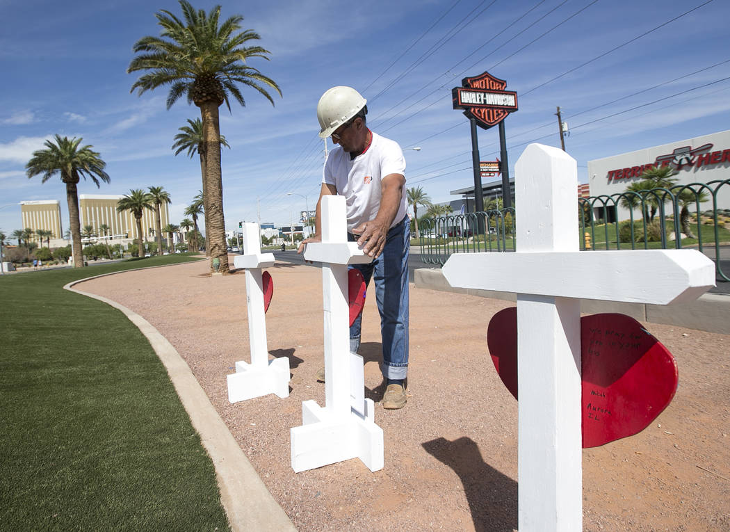 Greg Zanis, of Aurora, Ill., positions 58 crosses near the Welcome to Fabulous Las Vegas sign honoring victims of the Oct.1 shooting on Friday, Sept. 28, 2018. Monday marks the one-year anniversar ...