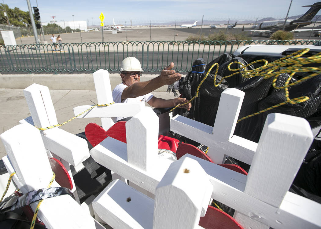 Greg Zanis, of Aurora, Ill., unloads several of the 58 crosses he placed near the Welcome to Fabulous Las Vegas sign honoring victims of the Oct.1 shooting on Friday, Sept. 28, 2018. Monday marks ...