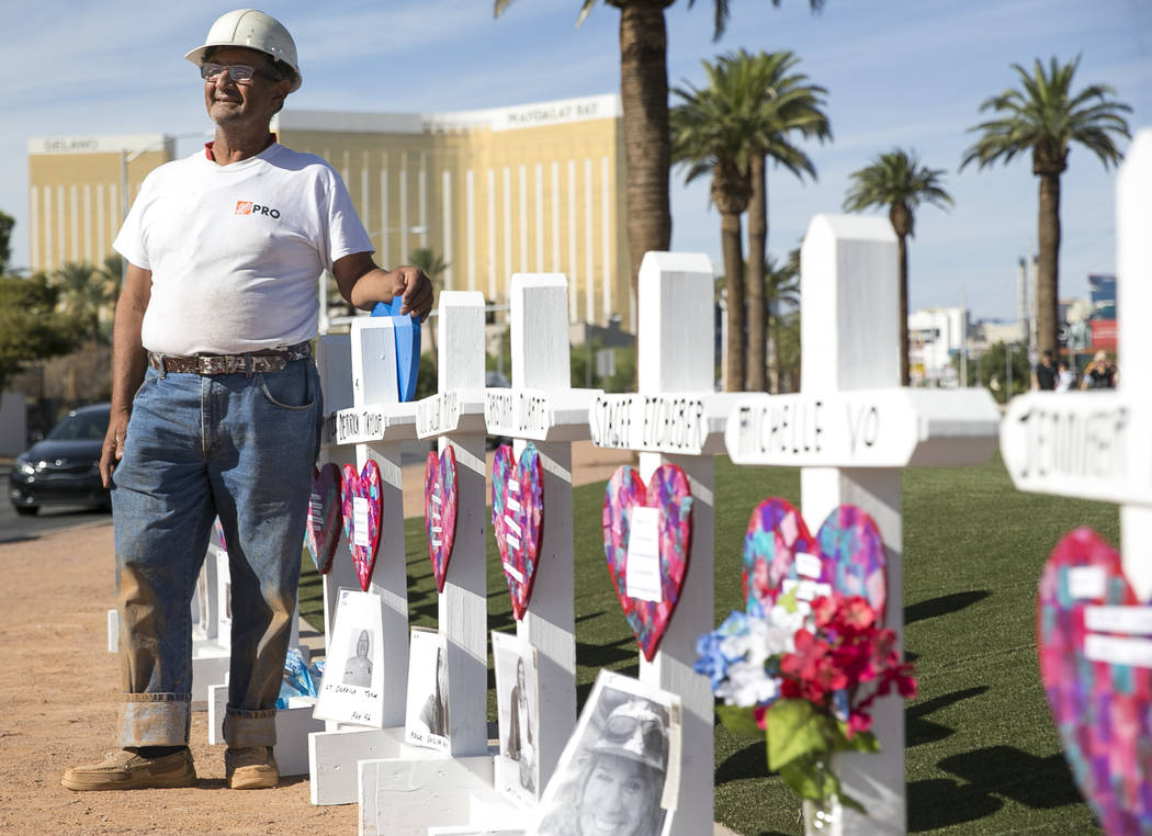 Greg Zanis, of Aurora, Ill., next to the 58 crosses he placed near the Welcome to Fabulous Las Vegas sign honoring victims of the Oct.1 shooting on Friday, Sept. 28, 2018. Monday marks the one-yea ...