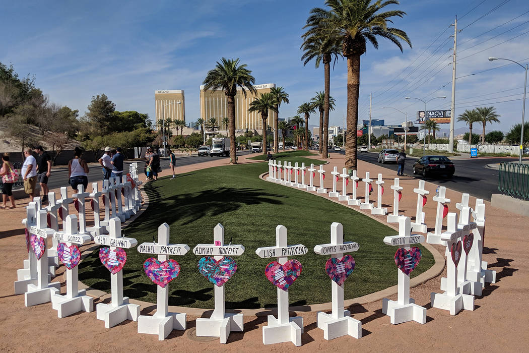 58 crosses honoring victims of the Oct.1 shooting are seen near the Welcome to Fabulous Las Vegas sign on Friday, Sept. 28, 2018. Monday marks the one-year anniversary since the massacre. Richard ...