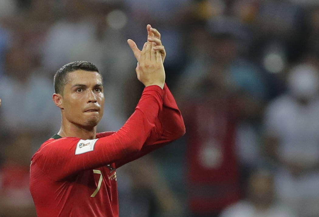 Portugal's Cristiano Ronaldo applauds after the group B match between Portugal and Spain at the 2018 soccer World Cup in the Fisht Stadium in Sochi, Russia, Friday, June 15, 2018. (AP Photo/Sergei ...