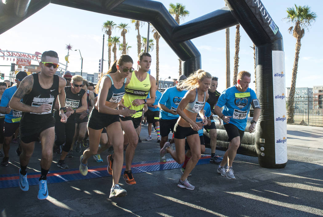 Runners take off at the start line at the Vegas Strong 5k/1-Mile, hosted by Jus Run, to commemorate the first anniversary of One October in Las Vegas, Sunday, Sept. 30, 2018. Caroline Brehman/Las ...