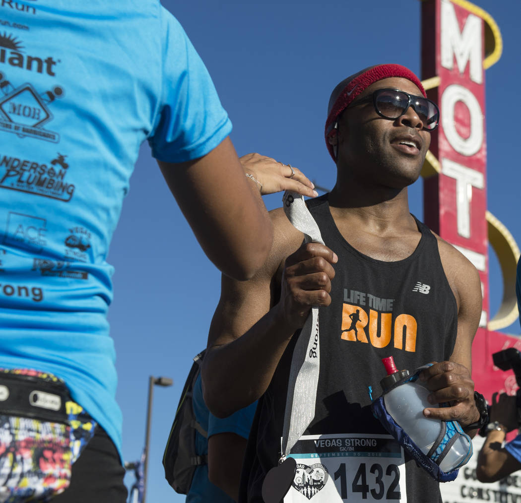 William Greens grabs a participation medal after completing the Vegas Strong 5k/1-Mile, hosted by Jus Run, to commemorate the first anniversary of One October in Las Vegas, Sunday, Sept. 30, 2018. ...