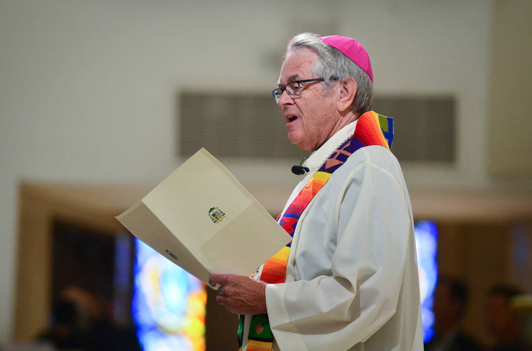 Bishop George Leo Thomas gives a welcome address during an interfaith service at Guardian Angel Cathedral in Las Vegas on Sunday, Sept. 30, 2018. The service, titled Dear Love: A Service of Hope, ...