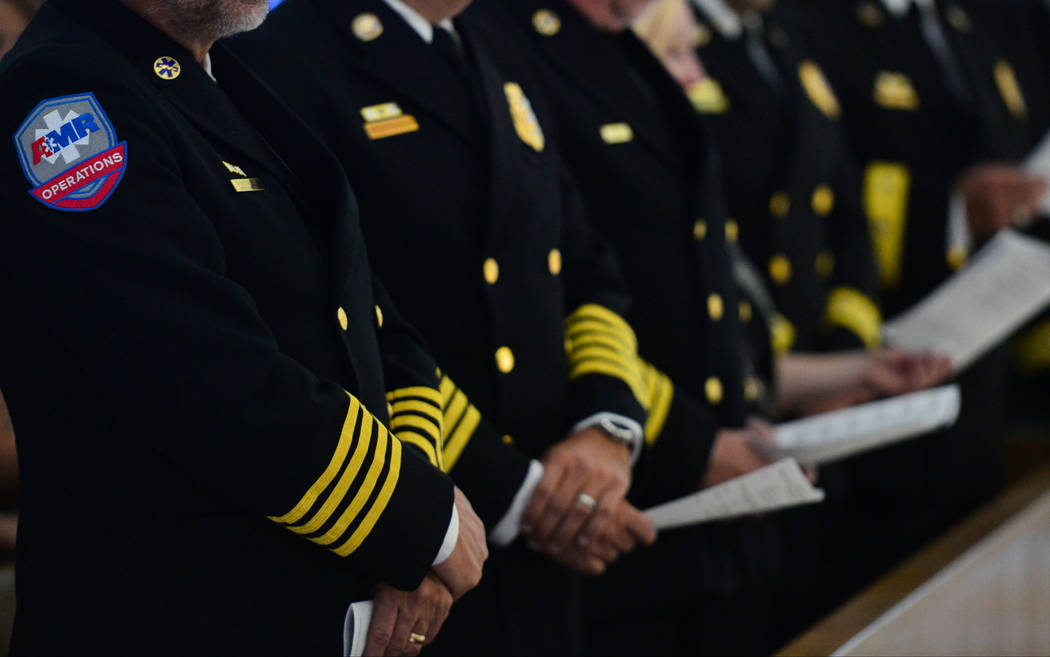 Members of local ambulance companies attend an interfaith service at Guardian Angel Cathedral in Las Vegas on Sunday, Sept. 30, 2018. The service, titled Dear Love: A Service of Hope, Healing, and ...