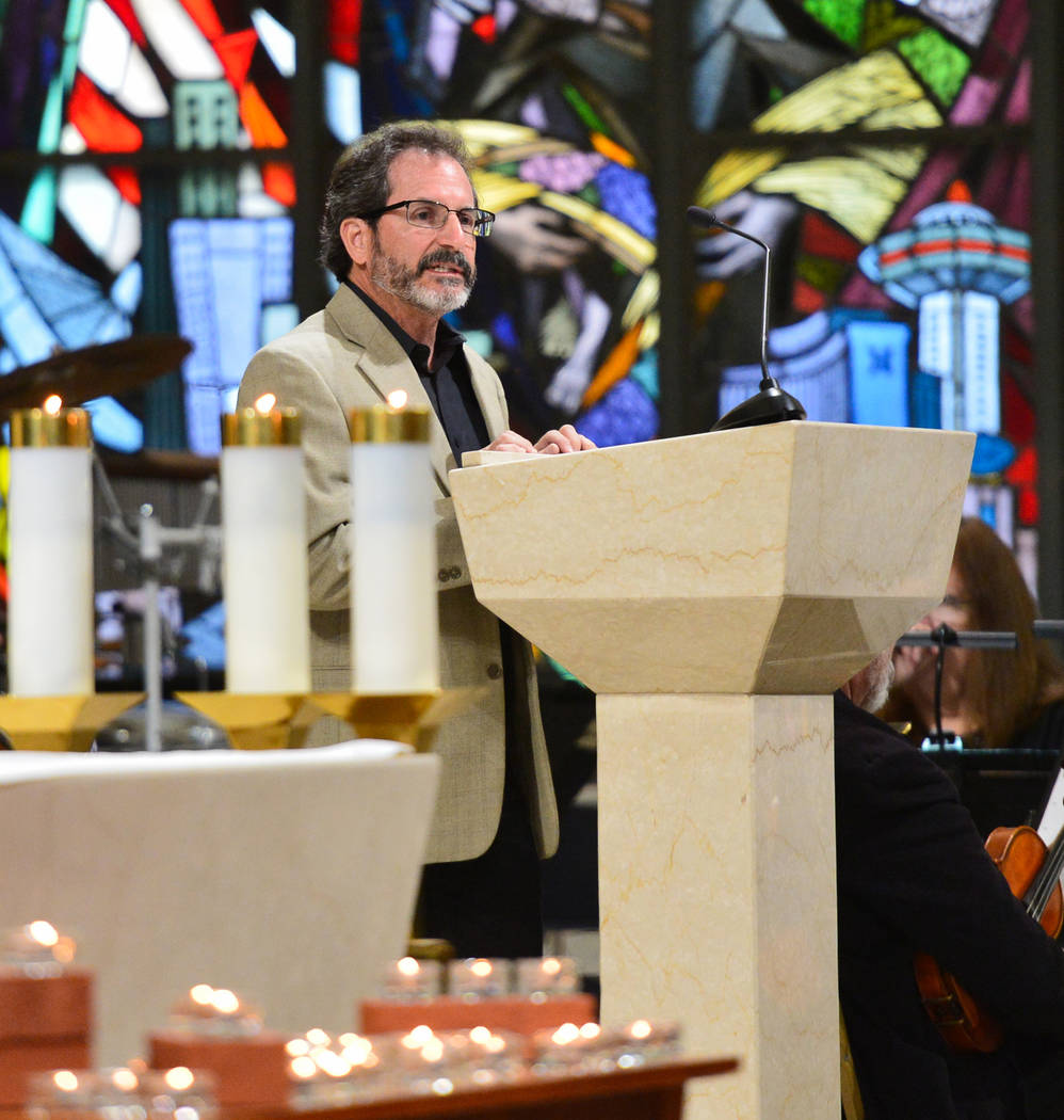 Freelance photographer David Becker talks about his experience on Oct. 1 during an interfaith service at Guardian Angel Cathedral in Las Vegas on Sunday, Sept. 30, 2018. The service, titled Dear L ...