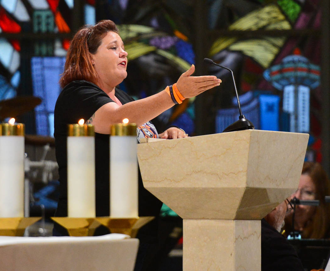 Mindy Scott, an Oct. 1 survivor, talks about her experience at the Route 91 music festival during an interfaith service at Guardian Angel Cathedral in Las Vegas on Sunday, Sept. 30, 2018. The serv ...