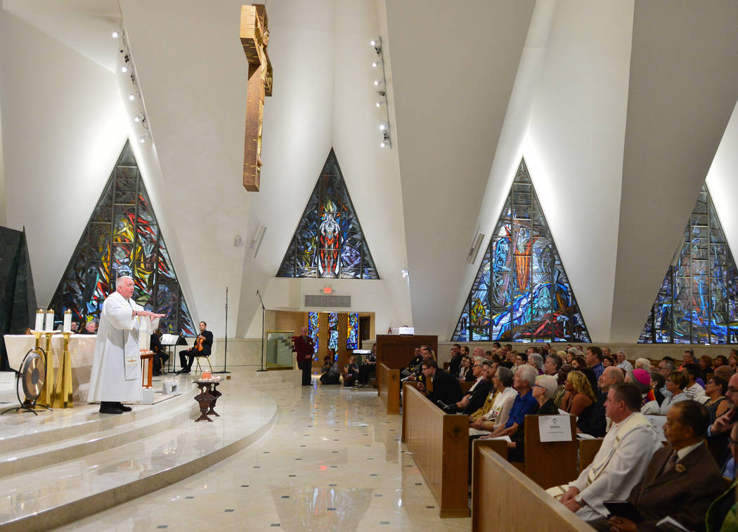 Bob Stoeckig, left, Vicker General of the diocese of Las Vegas, leads an interfaith service at Guardian Angel Cathedral in Las Vegas on Sunday, Sept. 30, 2018. The service, titled Dear Love: A Ser ...