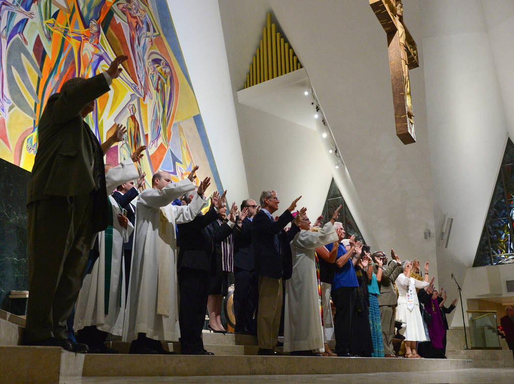 Interfaith religious leaders sing a song during an interfaith service at Guardian Angel Cathedral in Las Vegas on Sunday, Sept. 30, 2018. The service, titled Dear Love: A Service of Hope, Healing, ...