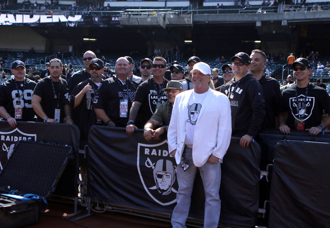 Oakland Raiders owner Mark Davis meets with Las Vegas Metro Police and Las Vegas Fire and Rescue members in Oakland, Calif., Sunday, Sept. 30, 2018. They were invited to the game against the Cleve ...