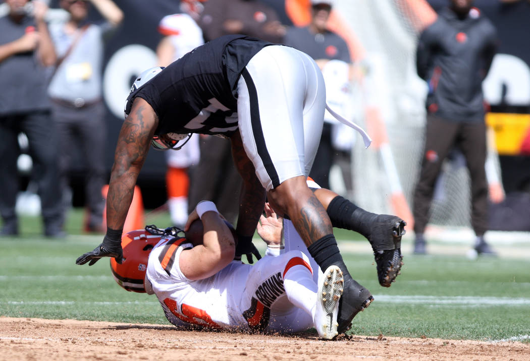 Oakland Raiders defensive end Bruce Irvin (51) sacks Cleveland Browns quarterback Baker Mayfield (6) during the first half of their NFL game in Oakland, Calif., Sunday, Sept. 30, 2018. Heidi Fang ...