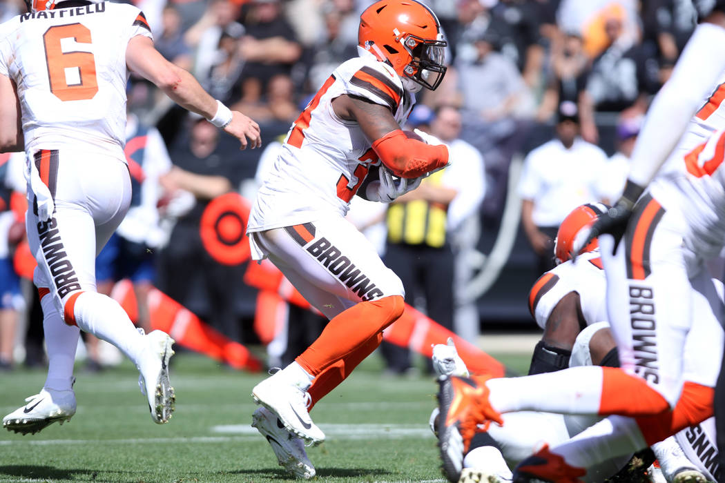 Cleveland Browns running back Carlos Hyde (34) runs with the football during the first half of their NFL game against the Oakland Raiders in Oakland, Calif., Sunday, Sept. 30, 2018. Heidi Fang Las ...