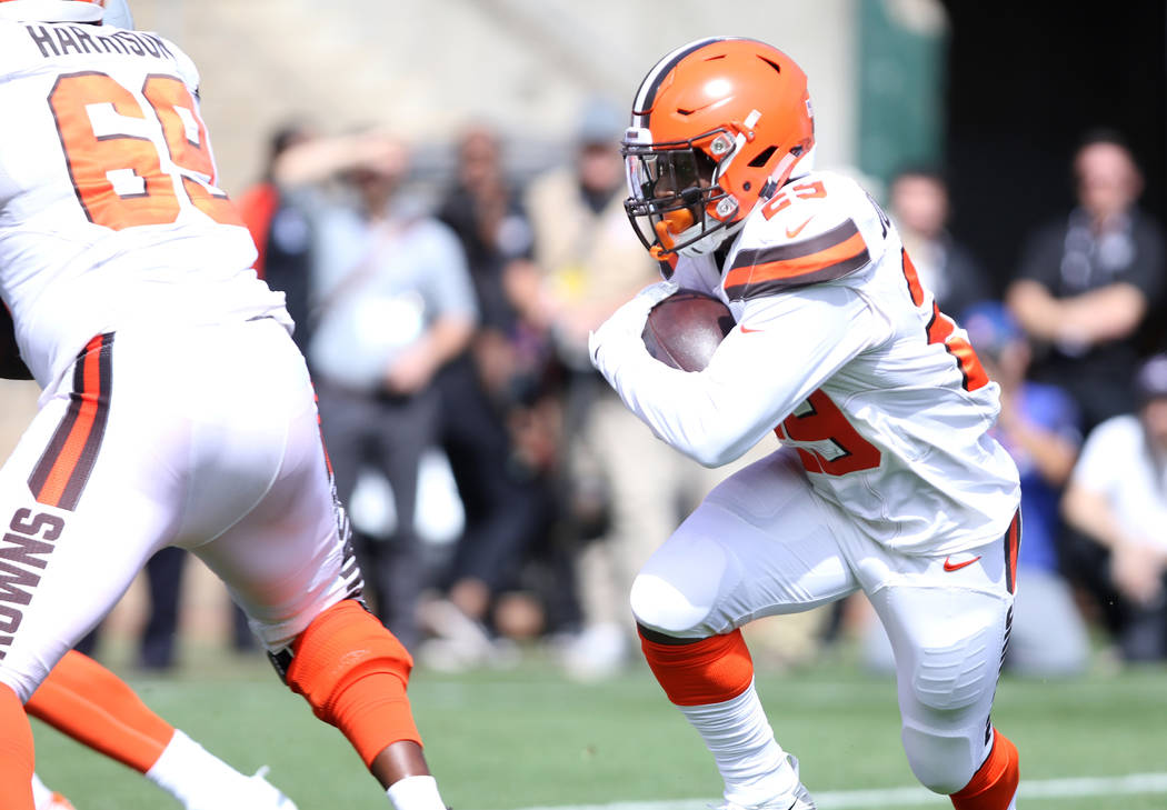 Cleveland Browns running back Duke Johnson (29) runs for a two-point conversion as offensive tackle Desmond Harrison (69) blocks for him during the first half of their NFL game against the Oakland ...