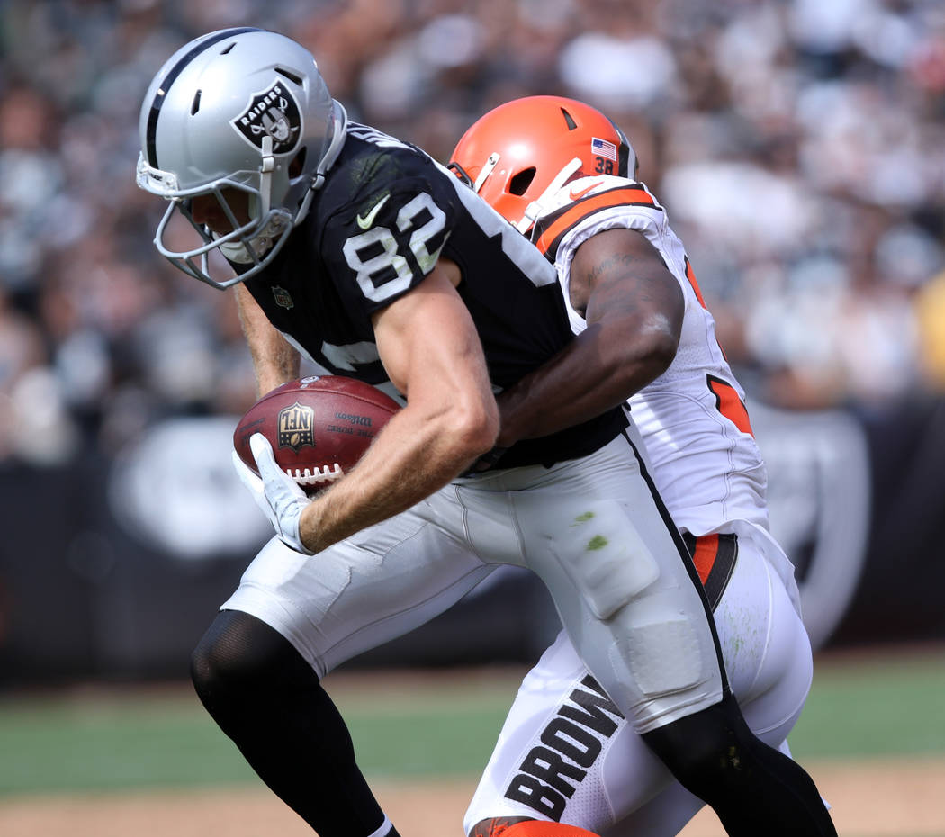 Oakland Raiders wide receiver Jordy Nelson (82) tries to break a tackle from Cleveland Browns defensive back T.J. Carrie (38) during the first half of their NFL game in Oakland, Calif., Sunday, Se ...