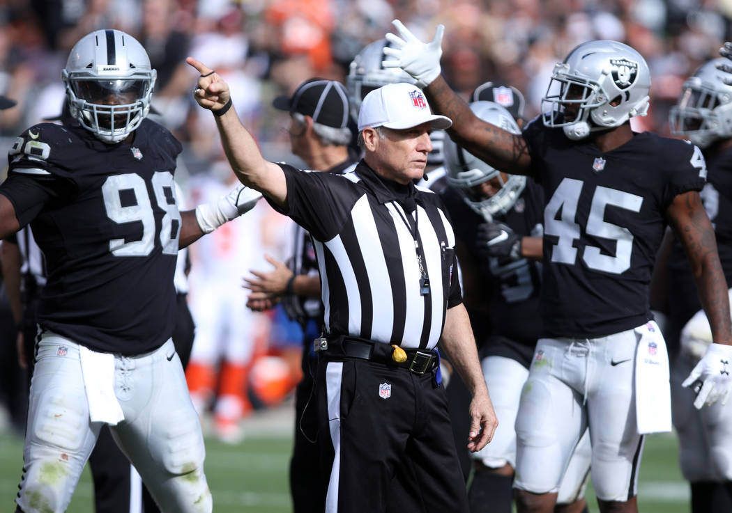 Oakland Raiders defensive back Dominique Rodgers-Cromartie (45) gestures and Oakland Raiders defensive tackle Frostee Rucker (98) celebrates as referee Walt Anderson (66) signals Oakland Raiders f ...