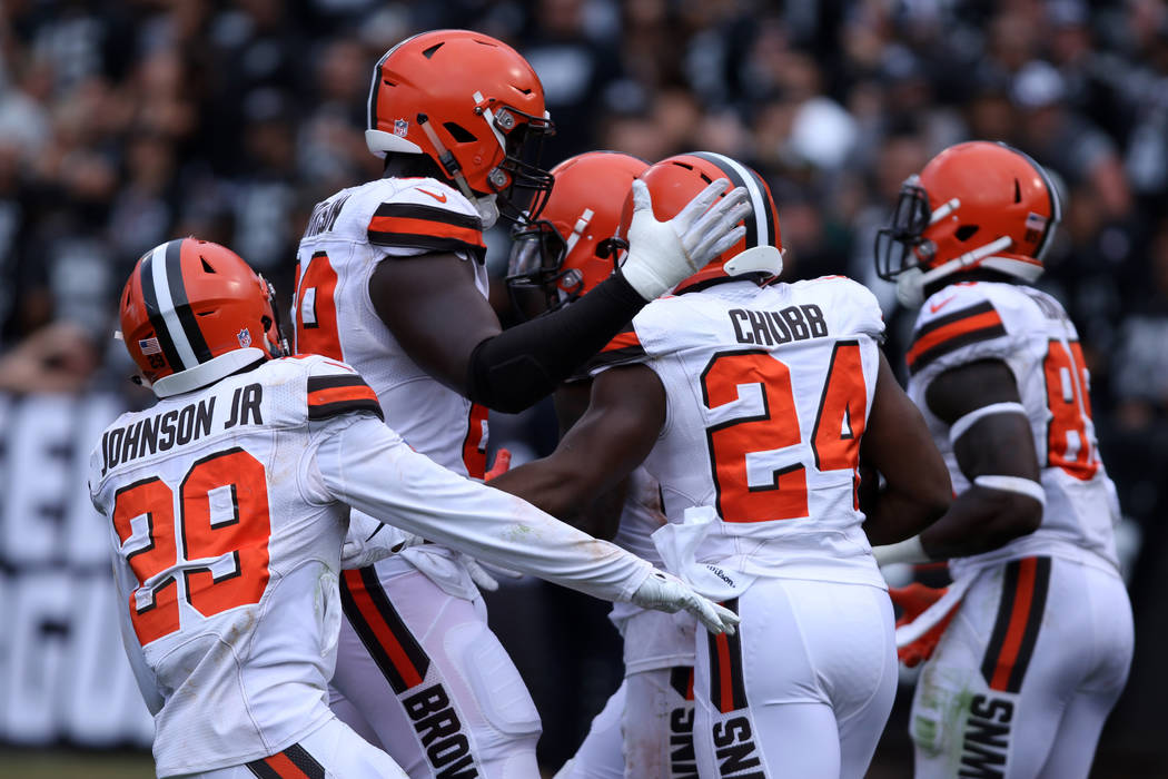 Cleveland Browns running back Nick Chubb (24) celebrates his touchdown against the Oakland Raiders with his teammates during the second half of their NFL game in Oakland, Calif., Sunday, Sept. 30, ...