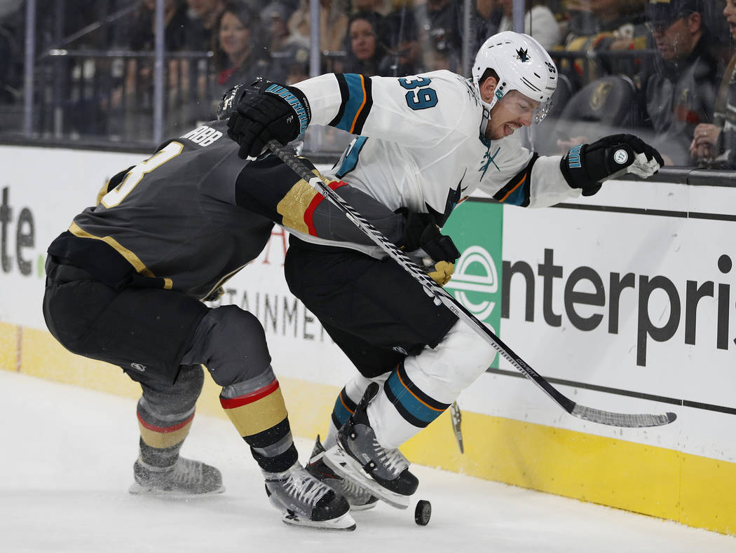 San Jose Sharks center Logan Couture (39) vies for the puck with Vegas Golden Knights defenseman Brayden McNabb (3) during the first period of a preseason NHL hockey game Sunday, Sept. 30, 2018, i ...