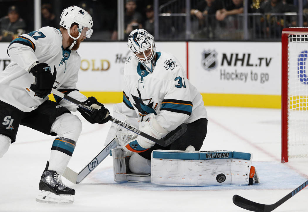 San Jose Sharks goaltender Martin Jones (31) blocks a shot by the Vegas Golden Knights during the second period of a preseason NHL hockey game, Sunday, Sept. 30, 2018, in Las Vegas. (AP Photo/John ...