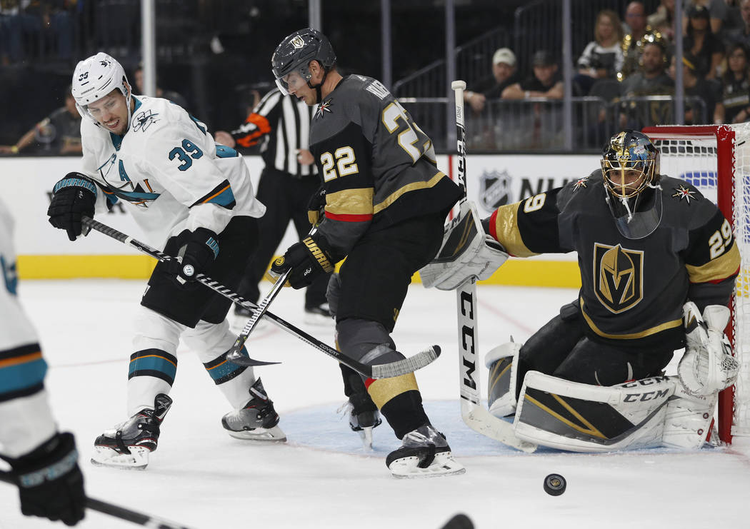 San Jose Sharks center Logan Couture (39) battles for the puck with Vegas Golden Knights defenseman Nick Holden during the first period of a preseason NHL hockey game Sunday, Sept. 30, 2018, in La ...