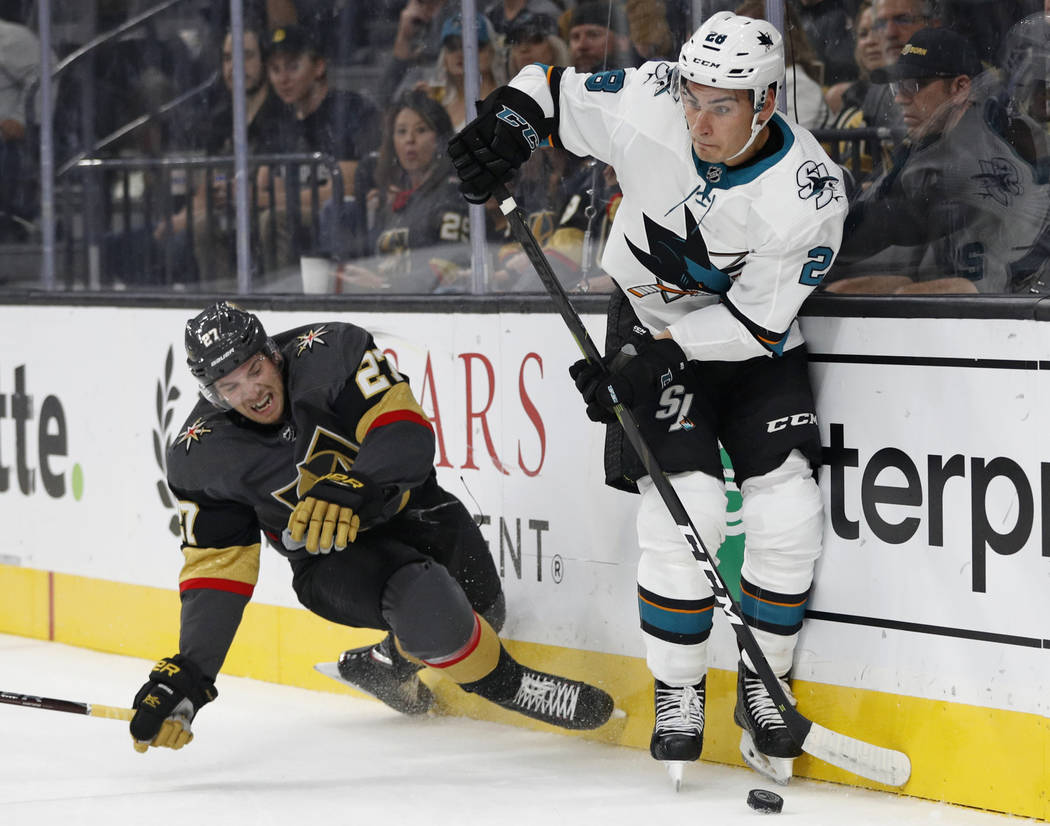 San Jose Sharks right wing Timo Meier (28) skates around Vegas Golden Knights defenseman Shea Theodore during the first period of a preseason NHL hockey game Sunday, Sept. 30, 2018, in Las Vegas. ...