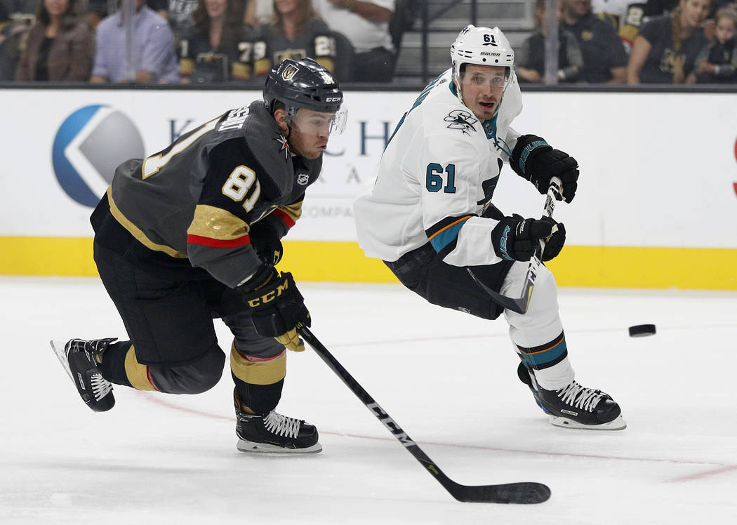 Vegas Golden Knights center Jonathan Marchessault (81) and San Jose Sharks defenseman Justin Braun (61) vie for the puck during the first period of a preseason NHL hockey game Sunday, Sept. 30, 20 ...