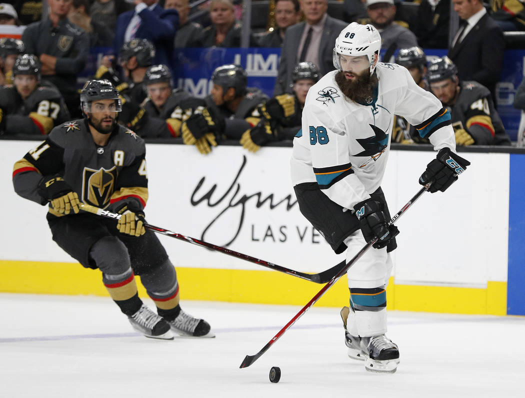 San Jose Sharks defenseman Brent Burns (88) skates around Vegas Golden Knights left wing Pierre-Edouard Bellemare (41) during the second period of a preseason NHL hockey game Sunday, Sept. 30, 201 ...