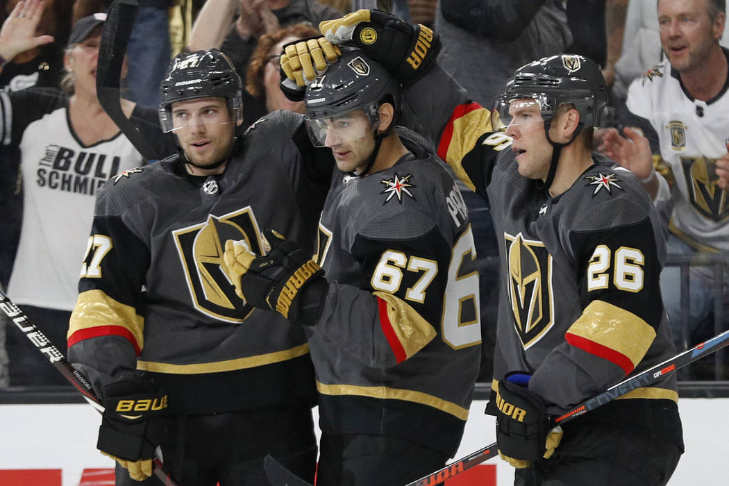 Vegas Golden Knights defenseman Shea Theodore, left, and center Paul Stastny, right, celebrate after left wing Max Pacioretty, center, scored against the San Jose Sharks during the second period o ...
