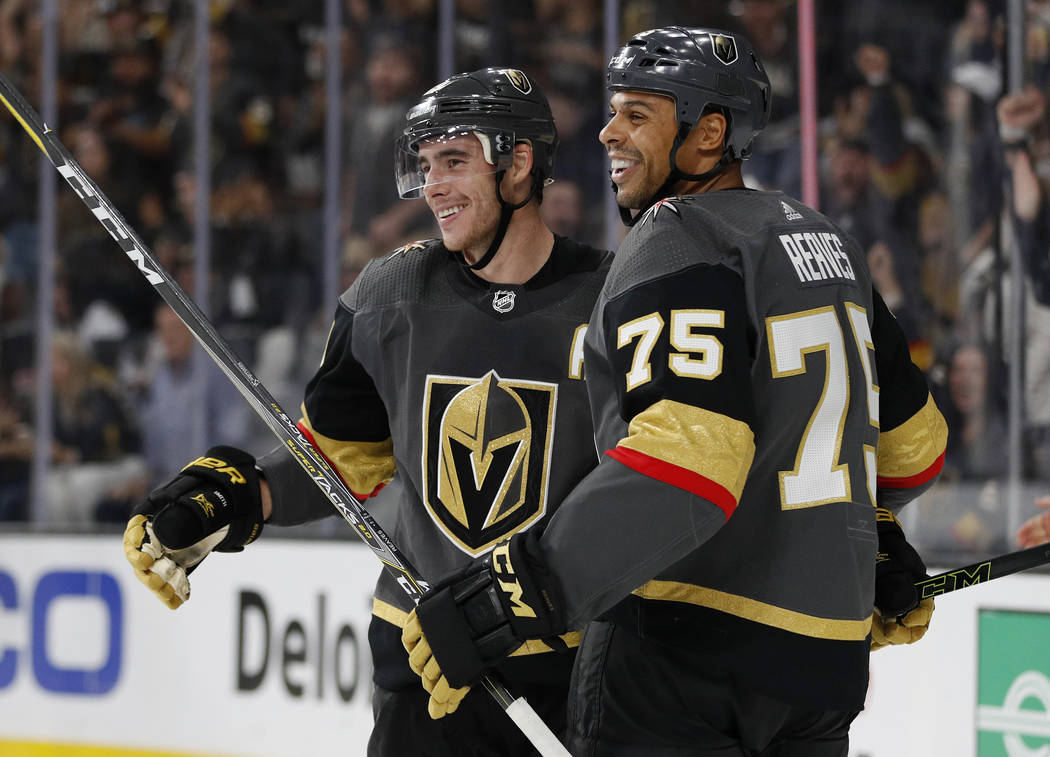 Vegas Golden Knights' Ryan Reaves, right, celebrates after Reilly Smith, left, scored against the San Jose Sharks during the second period of a preseason NHL hockey game Sunday, Sept. 30, 2018, in ...