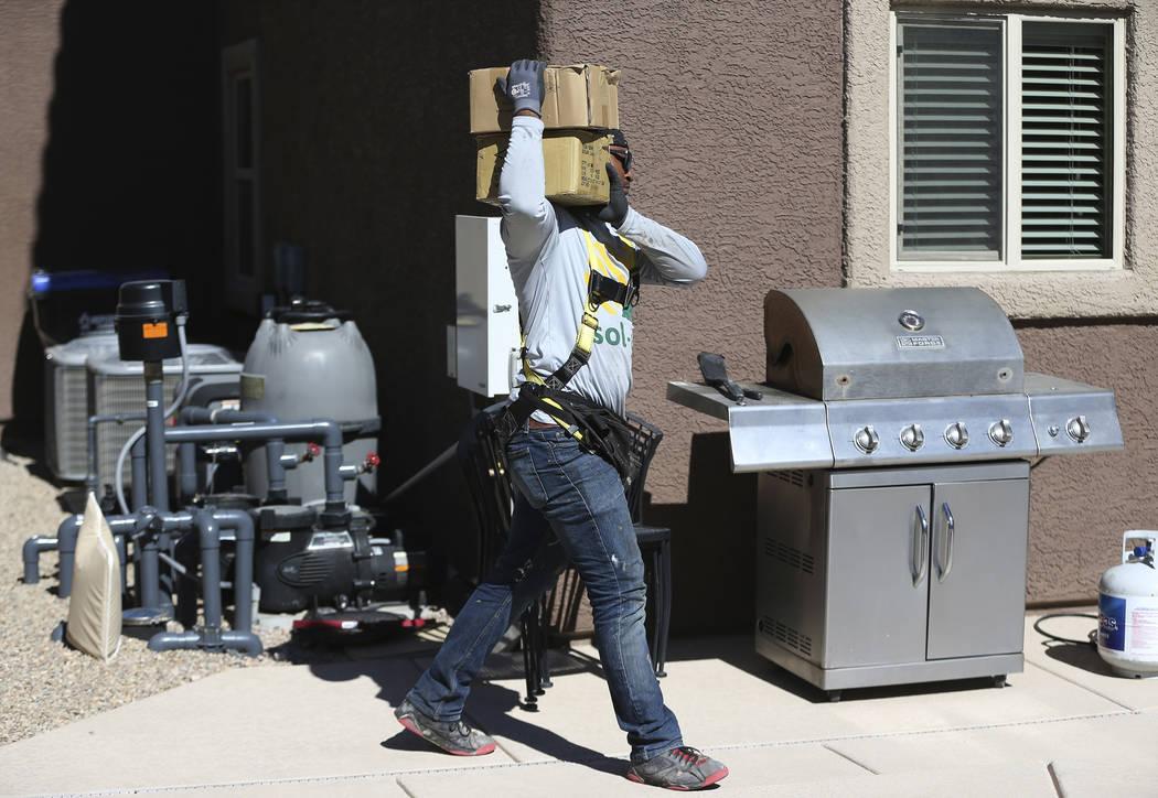 Brandon Lee, roof lead for Sol-Up, carries equipment for a residential solar panel installation in Henderson, Thursday, Oct. 18, 2018. Erik Verduzco Las Vegas Review-Journal @Erik_Verduzco