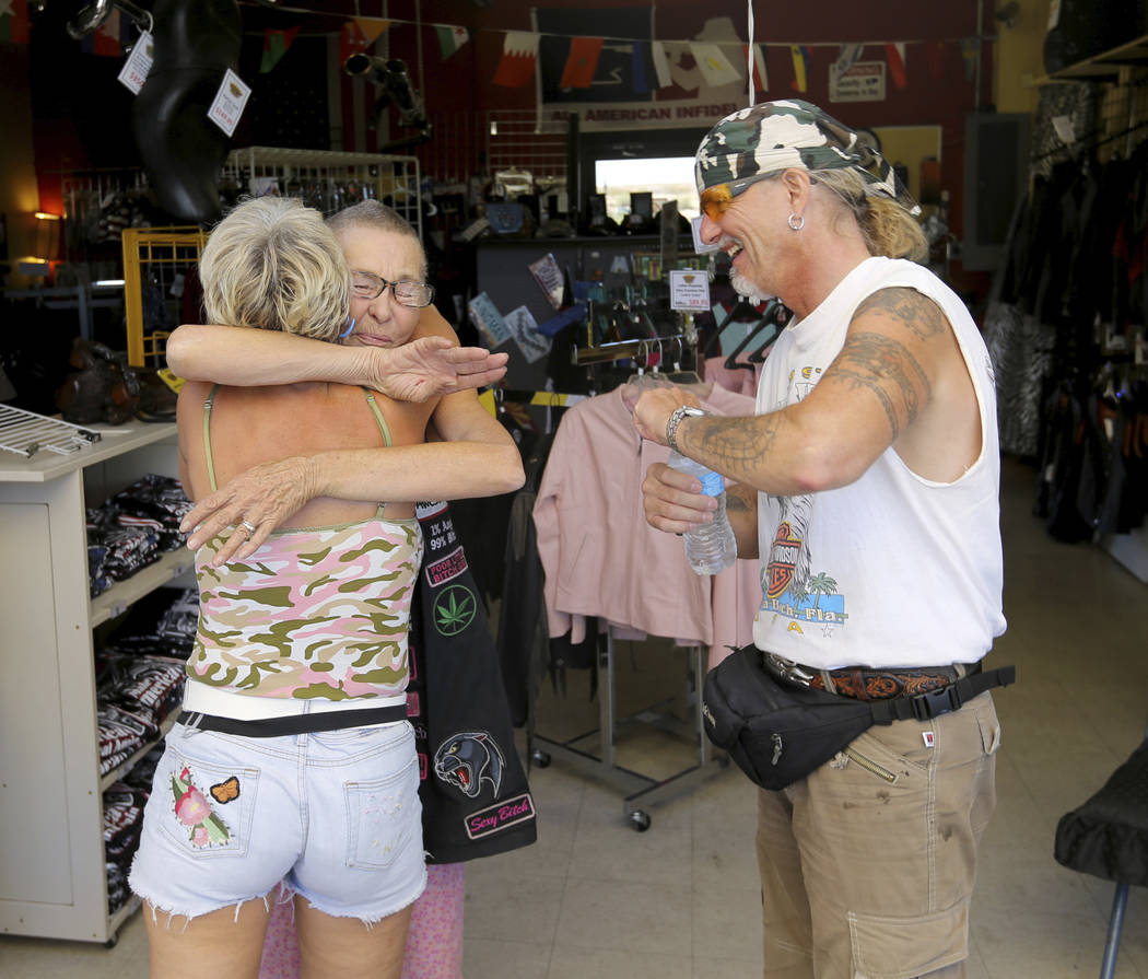 Shop Manager Karen Fasel-Cook, facing, hugs Astrid Hanni with Hans-Rudolf Leuthold, both of Switzerland, at Thunder-Rode Motorcycle Accessories in Kingman, Ariz. Wednesday, Sept. 12, 2018. K.M. Ca ...