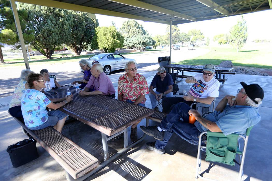 Friends visit at Lewis Kingman Park in Kingman, Ariz. Wednesday, Sept. 12, 2018. The friends are member of Arizona Car Nutz club. K.M. Cannon Las Vegas Review-Journal @KMCannonPhoto