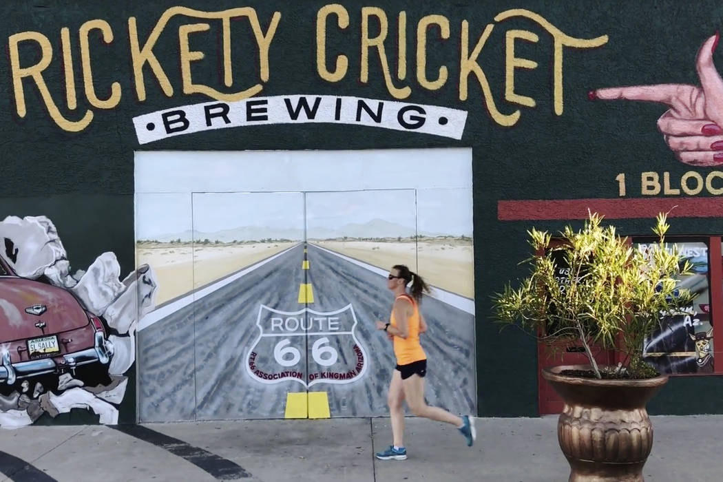 A runner jogs past a mural on Beale Street in Kingman, Ariz. Tuesday, Sept. 12, 2018. K.M. Cannon Las Vegas Review-Journal @KMCannonPhoto