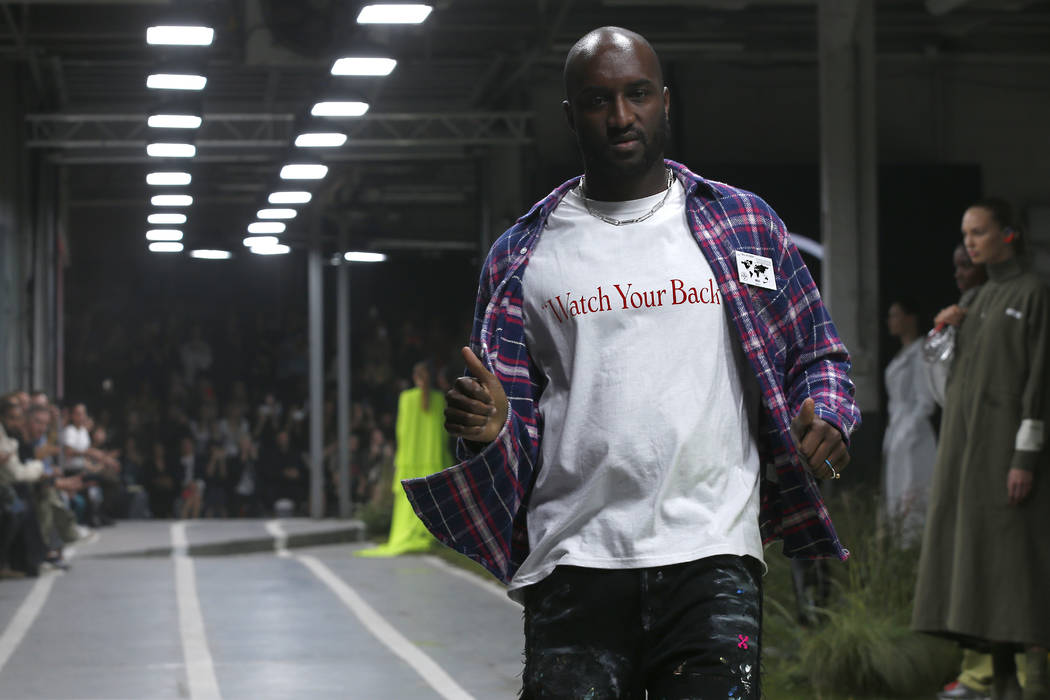 Designer Virgil Abloh accepts applause at the end of his the Off White Spring/Summer 2019 ready to wear fashion collection presented in Paris, Thursday, Sept. 27, 2018. (AP Photo/Thibault Camus)