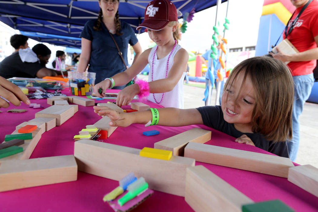 Loch Fauske, 4, and Pyper Goncz, 7, play with toothbrush cars at 9th Bridge School 3rd annual Kidz Street STEAM-inspired block party presented by Zappos at The Lot at the Western in downtown Las V ...