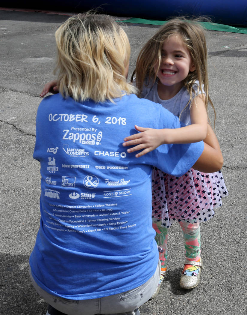 Valentina Haase, 4, hugs her teacher Harmoni Wallace at 9th Bridge School 3rd annual Kidz Street STEAM-inspired block party presented by Zappos at The Lot at the Western in downtown Las Vegas Satu ...