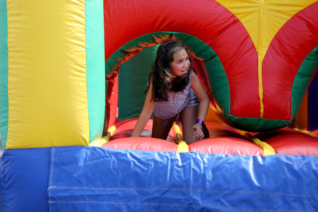Alexa Rangel, 8, plays in an inflatable maze at 9th Bridge School 3rd annual Kidz Street STEAM-inspired block party presented by Zappos at The Lot at the Western in downtown Las Vegas Saturday, Oc ...
