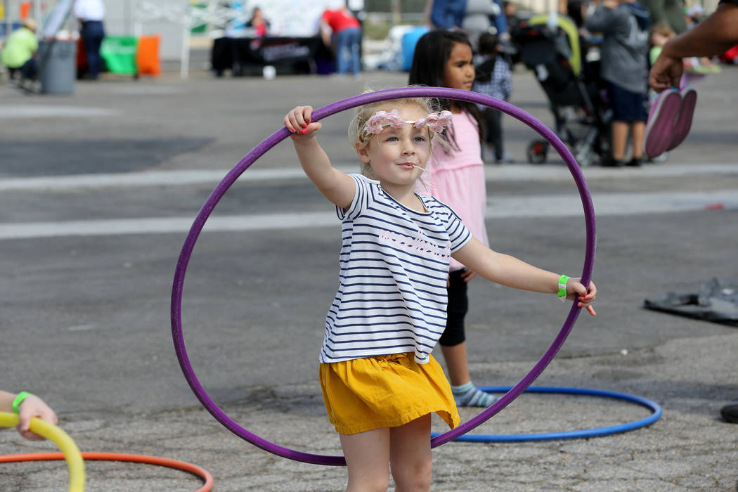 Presley Paige, 5, plays with a hula hoop at 9th Bridge School 3rd annual Kidz Street STEAM-inspired block party presented by Zappos at The Lot at the Western in downtown Las Vegas Saturday, Oct. 6 ...