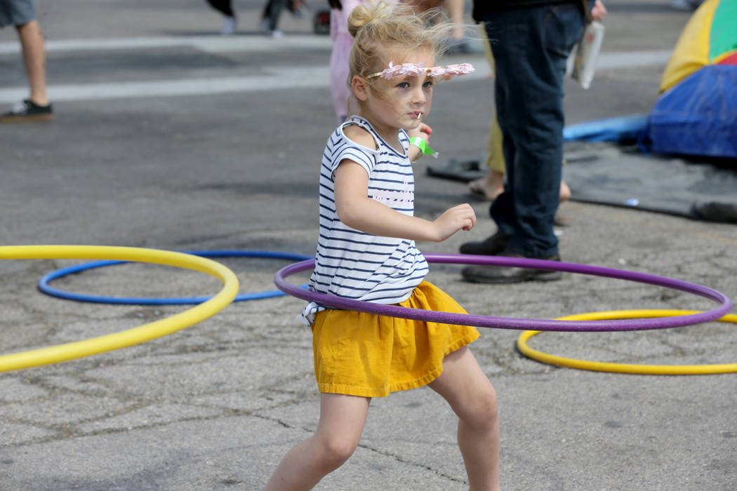 Presley Paige, 5, takes part in the hula hoop contest at 9th Bridge School 3rd annual Kidz Street STEAM-inspired block party presented by Zappos at The Lot at the Western in downtown Las Vegas Sat ...