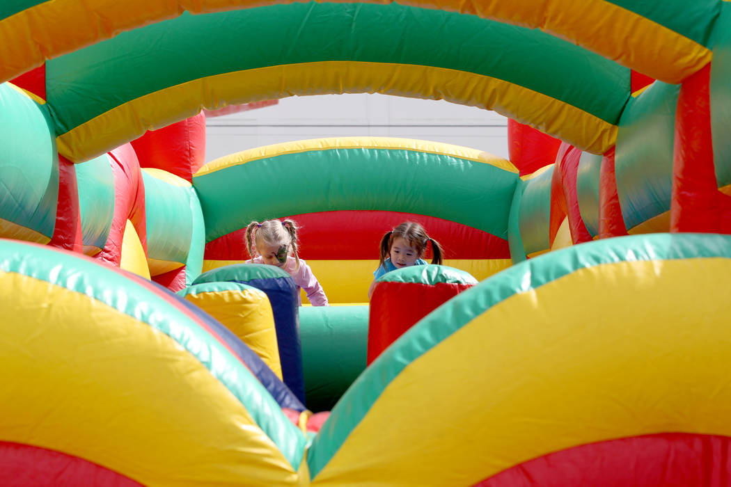 Girls play in an inflatable maze at 9th Bridge School 3rd annual Kidz Street STEAM-inspired block party presented by Zappos at The Lot at the Western in downtown Las Vegas Saturday, Oct. 6, 2018. ...