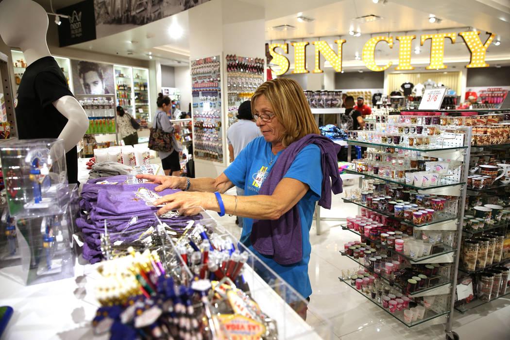 Sales associate Christina Rosenthal organizes shirts at the Welcome to Las Vegas gift shop at The Forum Shops in Las Vegas, Wednesday, July 18, 2018. Erik Verduzco Las Vegas Review-Journal @Erik_V ...