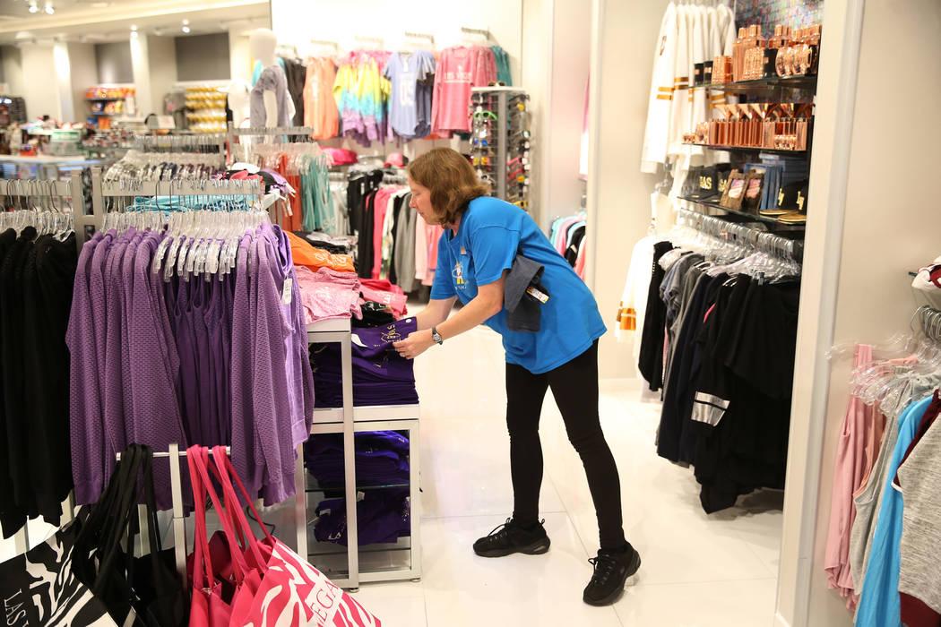 Supervisor Ginny Rogers organizes shirts at the Welcome to Las Vegas gift shop at The Forum Shops in Las Vegas, Wednesday, July 18, 2018. Erik Verduzco Las Vegas Review-Journal @Erik_Verduzco