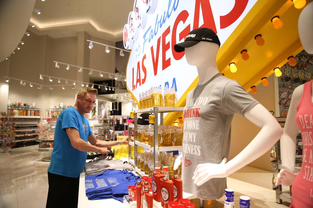 Area manager Eric Webster organizes souvenirs at the Welcome to Las Vegas gift shop at The Forum Shops in Las Vegas, Wednesday, July 18, 2018. Erik Verduzco Las Vegas Review-Journal @Erik_Verduzco