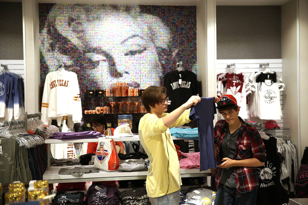 Tyler Olchawa of Arizona, left, with his cousin Jaeden Page of Wisconsin, browse the Welcome to Las Vegas gift shop at The Forum Shops in Las Vegas, Wednesday, July 18, 2018. Erik Verduzco Las Veg ...
