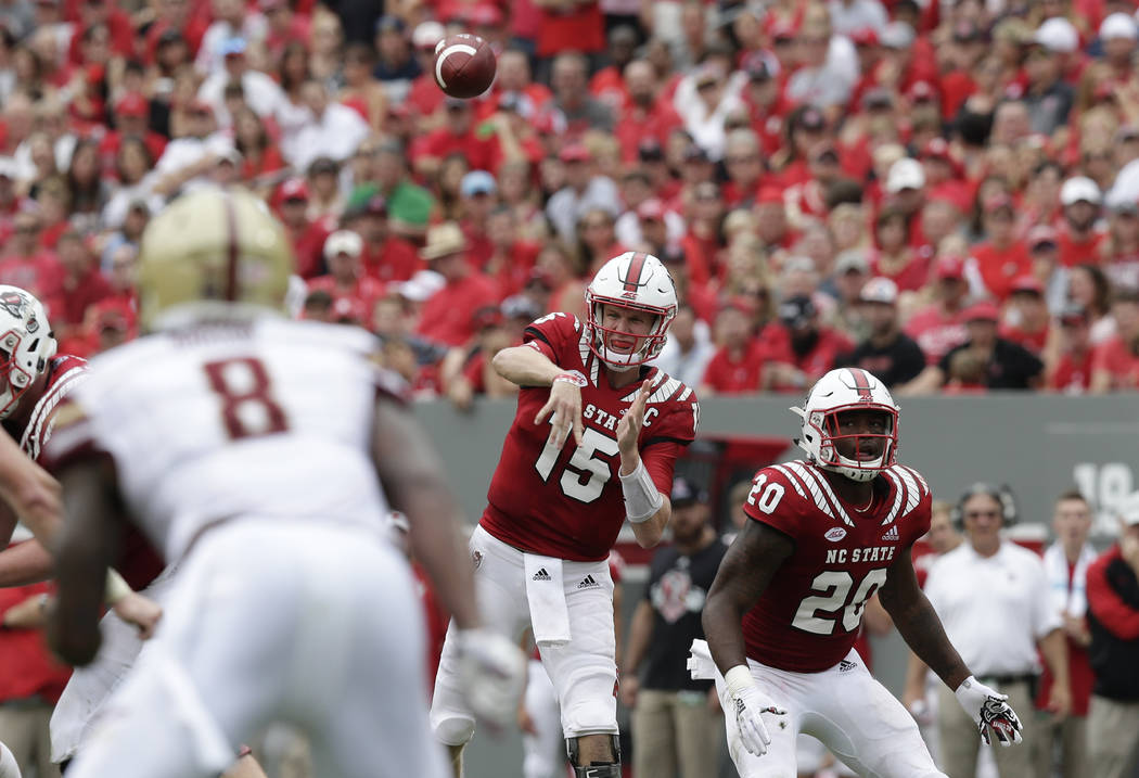 North Carolina State quarterback Ryan Finley (15) passes against Boston College during the first half an NCAA college football game in Raleigh, N.C., Saturday, Oct. 6, 2018. (AP Photo/Gerry Broome)