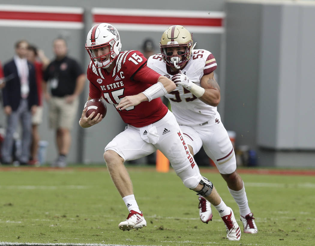 North Carolina State quarterback Ryan Finley runs against Boston College during the first half an NCAA college football game in Raleigh, N.C., Saturday, Oct. 6, 2018. (AP Photo/Gerry Broome)