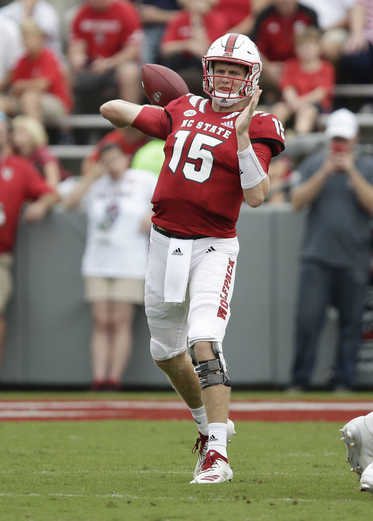 North Carolina State quarterback Ryan Finley passes against Boston College during the first half an NCAA college football game in Raleigh, N.C., Saturday, Oct. 6, 2018. (AP Photo/Gerry Broome)