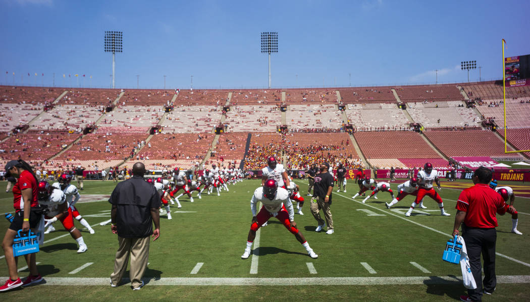 UNLV Rebels players practice before the start of a football game against the USC Trojans at the Los Angeles Memorial Coliseum in Los Angeles on Saturday, Sept. 1, 2018. Chase Stevens Las Vegas Rev ...
