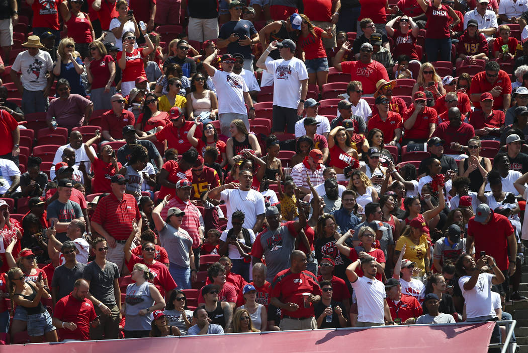 UNLV Rebels fans celebrate a touchdown against the USC Trojans during the first half of a football game at the Los Angeles Memorial Coliseum in Los Angeles on Saturday, Sept. 1, 2018. Chase Steven ...